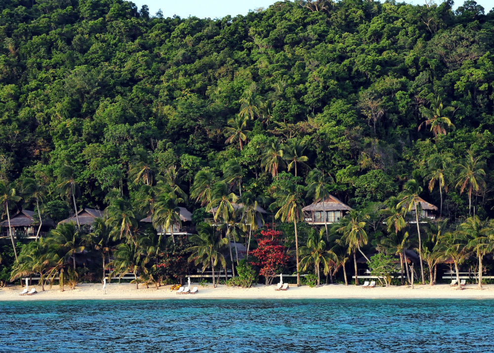 Explore eco-luxury in the rainforest or by the sea on Pangulasian Island in Philippines